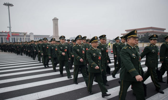 Military delegates arrive for the National People's Congress at the Great Hall of the People in Beijing on March 11, 2018. (NICOLAS ASFOURI/AFP/Getty Images)