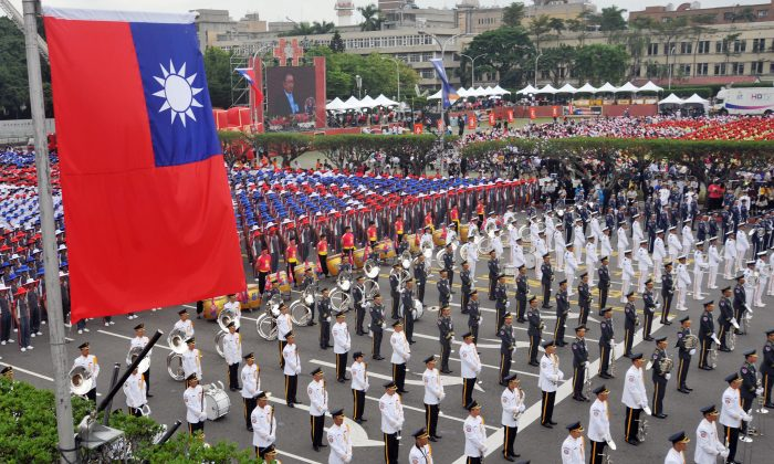 Members of a Taiwanese military band and people wearing hats in the colors of Taiwan's national flag take part in National Day celebrations in front of Taiwan's Presidential Office in Taipei on Oct. 10, 2012. (Mandy Cheng/AFP/Getty Images)