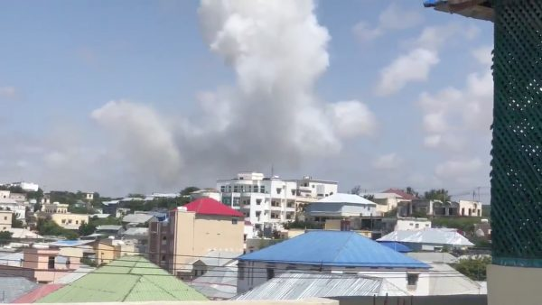 Smoke rises from the site of a suicide bomb blast