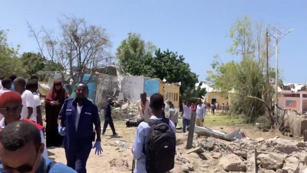 People look at debris of blast