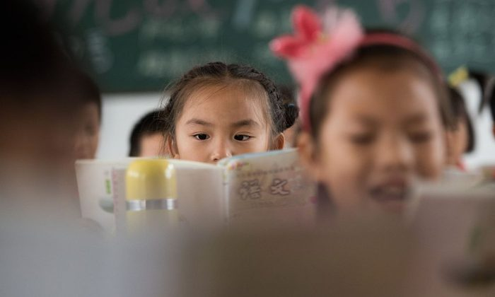 Chinese schoolchildren attend class at the Shiniuzhai Puan Center Primary School in Pingjiang County in China's Hunan Province, on Oct. 8, 2015. (Johannes Eisele/AFP/Getty Images)