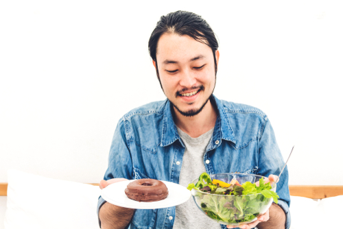 Cravings are complicated things driven by emotions and bacteria. But people who struggle with an unhealthy hunger for junk food can take steps to get their cravings under control. (Shutterstock)