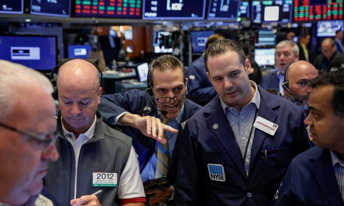Traders work on the floor of the New York Stock Exchange (NYSE) in New York, U.S., August 31, 2018. REUTERS/Brendan McDermid