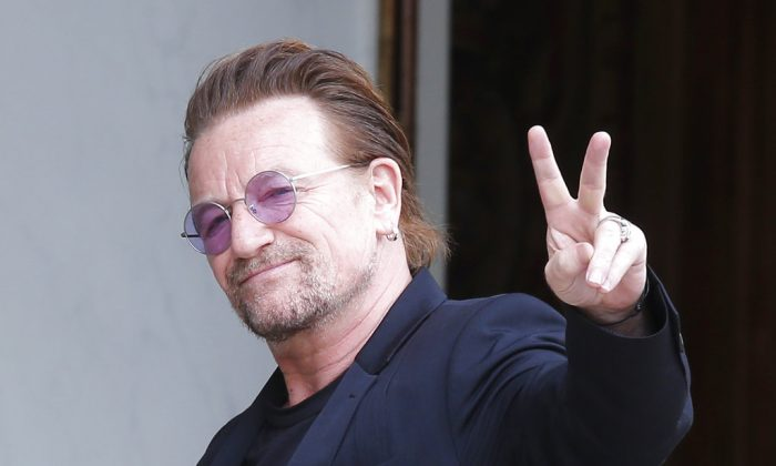 U2 singer Bono makes a peace sign as he arrives for a meeting at the Elysee Palace, in Paris, France on July 24, 2017. (AP/Michel Euler/ file)