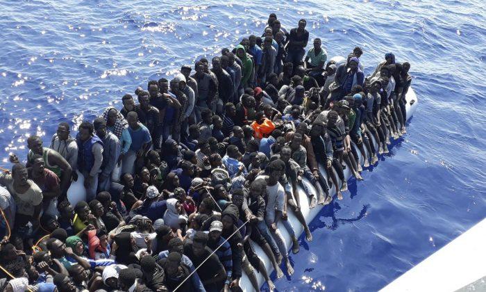Migrants on a ship intercepted offshore on June 24, 2018, near the town of Gohneima, east of Tripoli, Libya. (Libyan Coast Guard/File Photo via AP)