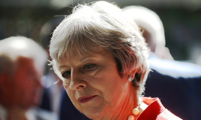 British Prime Minister Theresa May visits the Royal Welsh Show on July 26, 2018 in LLanelwedd, Wales. May announced an inquiry into the tainted blood scandal in 2017. (Christopher Furlong - WPA Pool/Getty Images)