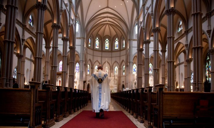Father Kris Stubna walks to the sanctuary following a mass to celebrate the Assumption of the Blessed Virgin Mary at St Paul Cathedral, the mother church of the Pittsburgh Diocese in Pittsburgh, Pennsylvania, on Aug. 15, 2018. (Jeff Swensen/Getty Images)