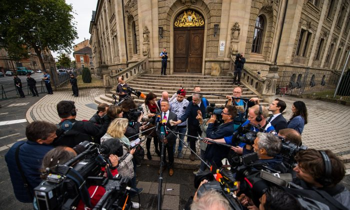Maximilian Endler, the defendant's lawyer, answers questions outside the regional courthouse during the trial of Abdul D in the German western town of Landau on Sept. 3, 2018. (Andreas Arnold/AFP/Getty Images)
