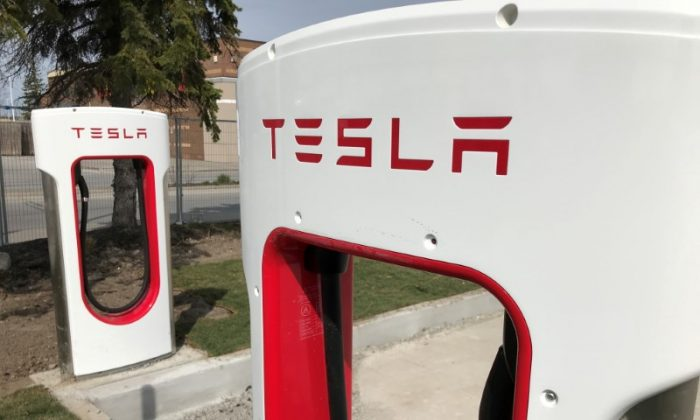 FILE PHOTO: Tesla superchargers are installed at the Quinte Mall in Belleville, Ontario, Canada, May 6, 2018. REUTERS/David Lucas/File Photo
