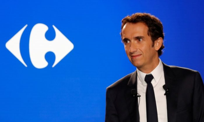 FILE PHOTO: Alexandre Bompard, chief executive officer of French retailer Carrefour, addresses a news conference in La Defense, near Paris, France, January 23, 2018. REUTERS/Philippe Wojazer/File Photo