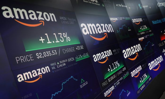 The Amazon.com logo and stock price information is seen on screens at the Nasdaq Market Site in New York City, New York, U.S., September 4, 2018. (Reuters/Mike Segar).