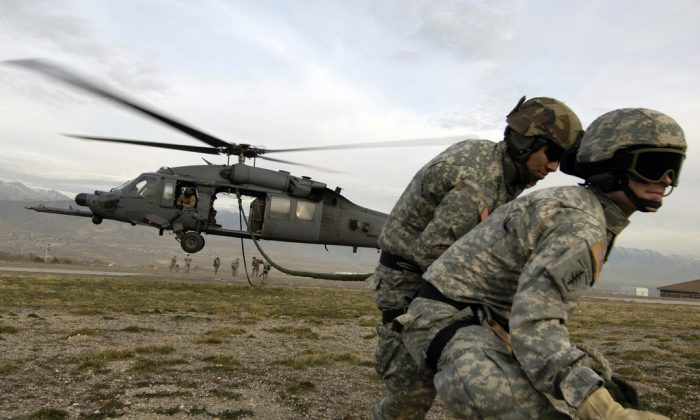 U.S. Army Soldiers from the 19th Special Forces, Utah National Guard retrieve a fast rope after being dropped into a Utah landing zone on Nov. 9, 2007, during a combat search and rescue exercise. (U.S. Air Force photo by Master Sgt. Kevin J. Gruenwald)