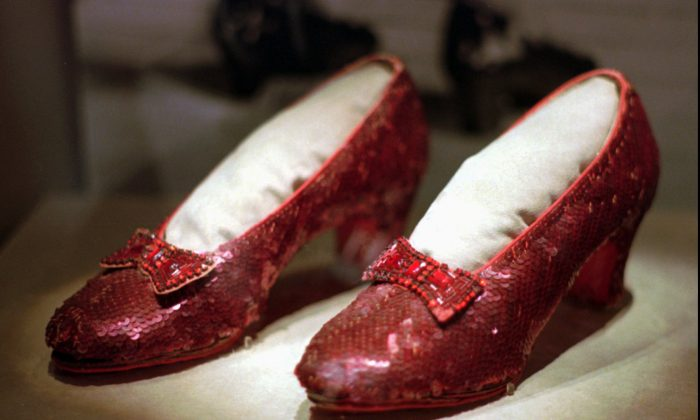 "This April 10, 1996, file photo shows one of the four pairs of ruby slippers worn by Judy Garland in the 1939 film ""The Wizard of Oz"" on display during a media tour of the ""America's Smithsonian"" traveling exhibition in Kansas City.(Ed Zurga/AP )"