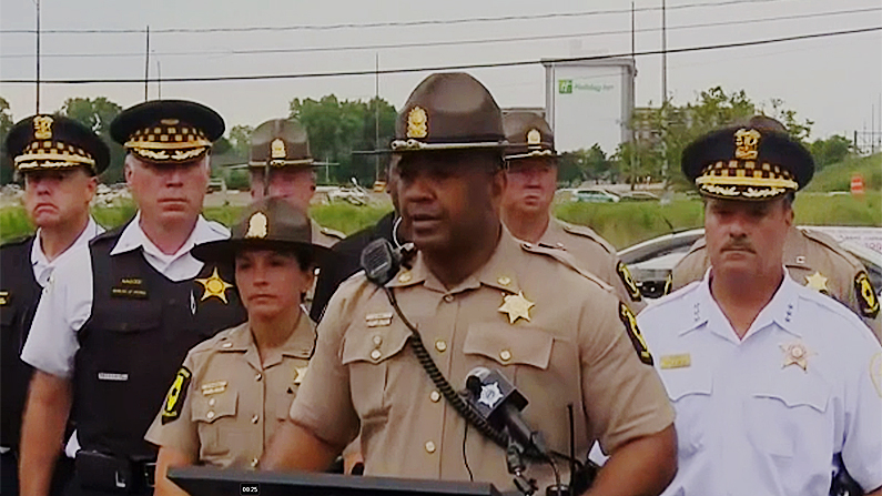 Illinois State Police Major David Byrd addresses the media