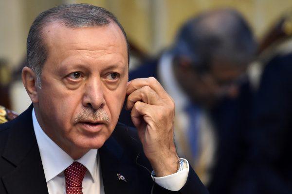 Turkish president Tayyip Erdogan listens