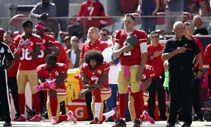 Colin Kaepernick, #7, of the San Francisco 49ers kneels for the National Anthem before their game against the Tampa Bay Buccaneers at Levi's Stadium in Santa Clara, Calif., on Oct. 23, 2016. (Ezra Shaw/Getty Images)