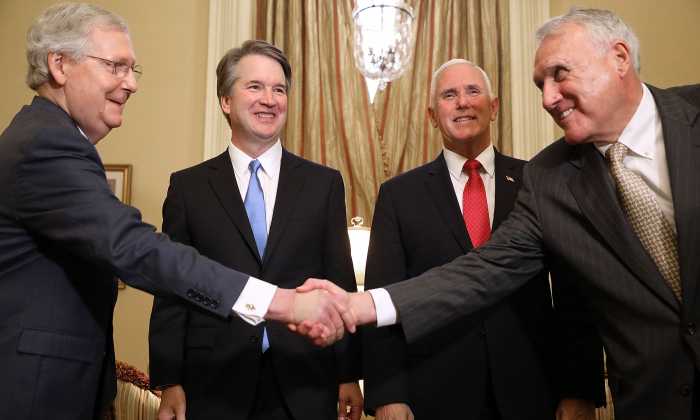 (L-R) Senate Majority Leader Mitch McConnell (R-KY), Judge Brett Kavanaugh, Vice President Mike Pence and former Sen. Jon Kyl (R-AZ) greet one another before a meeting in McConnell's office in the U.S. Capitol July 10, 2018 in Washington. (Chip Somodevilla/Getty Images)
