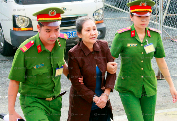 U.S. citizen Angel Phan (C) is escorted by police to a court before her trial in Ho Chi Minh city, Vietnam on Aug. 21, 2018. (Stringer/Reuters)