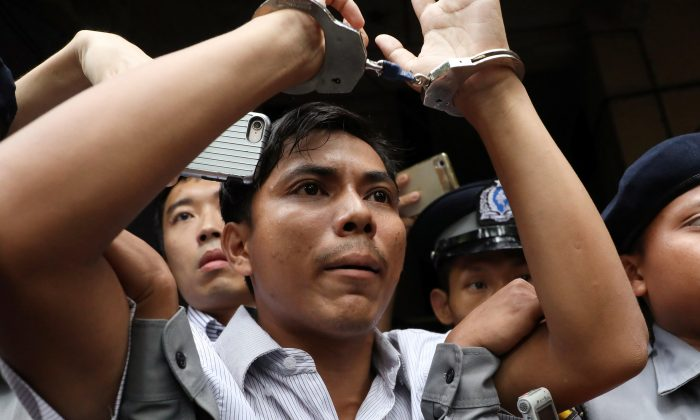 Reuters journalists Kyaw Soe Oo leaves after listening to the verdict at Insein court in Yangon, Burma on Sept. 3, 2018. (Ann Wang/Reuters)