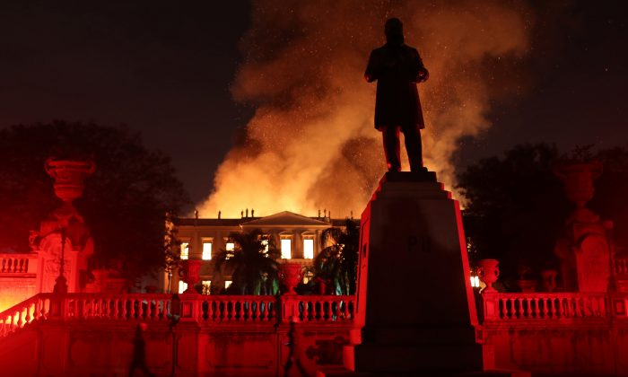 Firefighters try to extinguish a fire at the National Museum of Brazil in Rio de Janeiro. (Ricardo Moraes/Reuters)