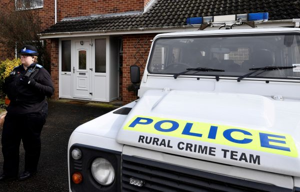 A police officer stands guard outside the home of Skripal