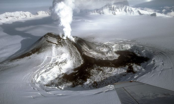 File Photo: Veniaminof volcano in the waning stages of the 1983 to 1984 eruption. (M.E. Yount, U.S. Geological Survey)
