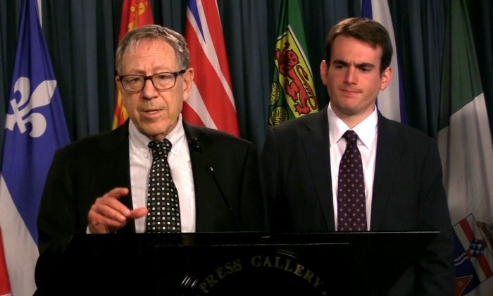 Irwin Cotler (L), chair of the Raoul Wallenberg Centre for Human Rights, speaks at a press conference on Parliament Hill in Ottawa on Aug. 30, 2018. With him is Brandon Silver, the director of policy and projects at the centre. (Limin Zhou/The Epoch Times)
