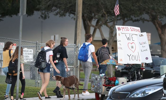 Students walk to Marjory Stoneman Douglas High School on the first day of school on Aug. 15, 2018 in Parkland, Florida. Former student Nikolas Cruz, 19, is accused of killing 17 students and faculty members at the school on Feb. 14, 2018 during the last school year.  (Joe Raedle/Getty Images)