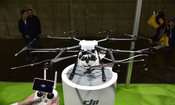 A DJI crop-spraying drone is displayed during the SIMA (Mondial des Fournisseurs de l'Agriculture et de l'Elevage) 2017 at the Parc des Expositions Paris Nord in Villepinte, France, on Feb. 26, 2017. (Christophe Archambault/AFP/Getty Images)