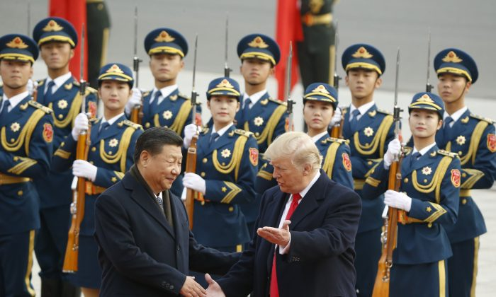 Chinese leader Xi Jinping greets U.S. President Donald Trump at a welcoming ceremony on Nov. 9, 2017 in Beijing. (Thomas Peter-Pool/Getty Images)