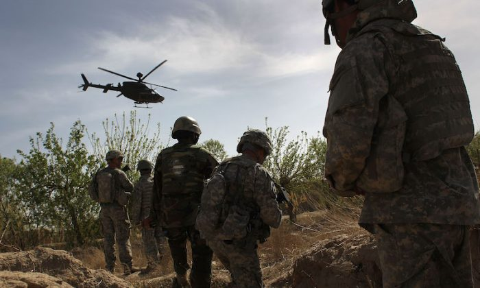 File photo: U.S. and Afghan Army soldiers in Kandahar province, Afghanistan, March 15, 2010. (John Moore/Getty Images)