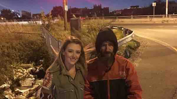 Kate McClure and John Bobbitt stand near I-95