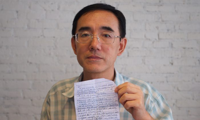 Sun Yi holding the SOS letter he wrote, which made its way around the world and back to him. (Courtesy Flying Cloud Productions)