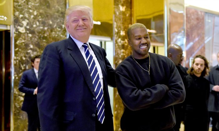 Singer Kanye West and President-elect Donald Trump speak with the press after their meeting at Trump Tower in New York on Dec. 13, 2016. (TIMOTHY A. CLARY/AFP/Getty Images)
