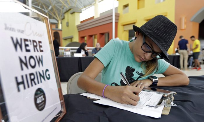 A job seeker fills out an application at a job fair in this file photo. Canadian small- and medium-sized firms are desperate to hire more young workers.(AP Photo/Alan Diaz, File)