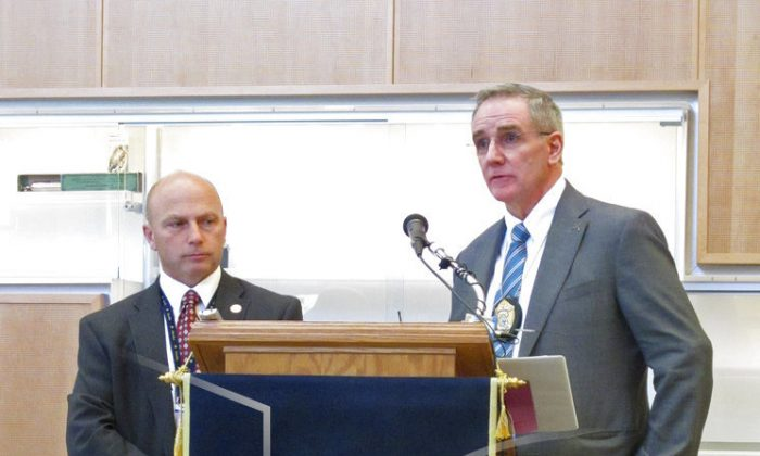 Alaska State Trooper Capt. Michael Duxbury, right, and Lt. Steve Adams, speak at a news conference in Anchorage, Alaska on Sept. 5, 2018. (AP Photo/Rachel D'Oro)