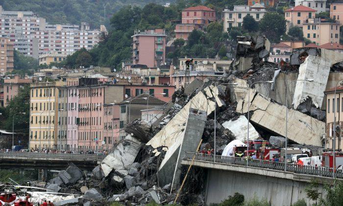 The collapsed Morandi Bridge in the Italian port city of Genoa, Italy, on Aug. 14. (Reuters/Stefano Rellandini)