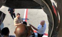 CDC Officials Meet Ill Plane Passengers