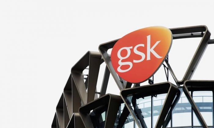 The GlaxoSmithKline (GSK) logo is seen on top of GSK Asia House in Singapore, on March 21, 2018. REUTERS/Loriene Perera/File Photo