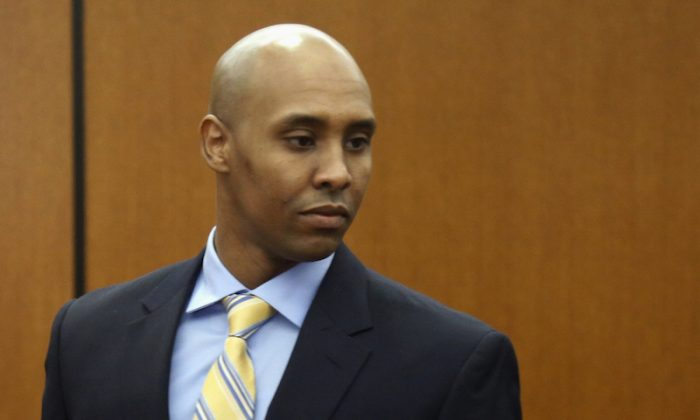 Former Minneapolis police officer Mohamed Noor arrives at the Hennepin County Government Center for a hearing in Minneapolis in this May 8, 2018, file photo. Noor is charged in the July 2017 shooting death of Justine Ruszczyk Damond, of Australia, who had called 911 to report a possible assault. (Jim Mone/AP)