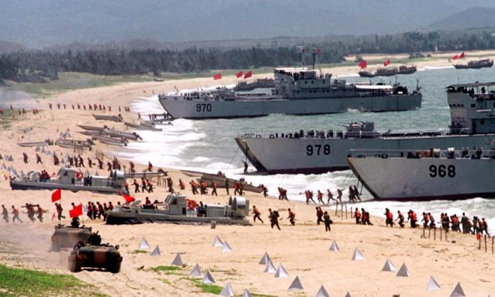 People's Liberation Army (PLA) storm ashore from landing crafts in an exercise on the mainland coast close to Taiwan on Sept. 10, 1999.  (STR/AFP/Getty Images)