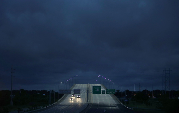 Vehicles pass over a U.S. route 90 bridge as Tropical Storm Gordon continues to produce sporadic rain and wind on Sept. 4, 2018 in Pascagoula, Mississippi.  (Photo by Joe Raedle/Getty Images)