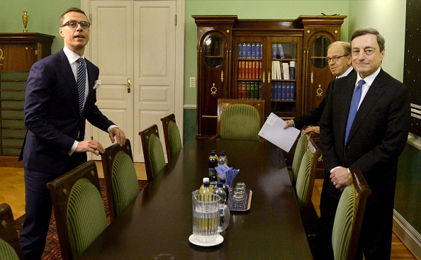 (LtoR) Finnish Prime Minister Alexander Stubb, governor of the Bank of Finland Erkki Liikanen and Mario Draghi, President of the European Central Bank (ECB), arrive for a meeting in Helsinki on Nov. 27, 2014.  (VESA MOILANEN/AFP/Getty Images)