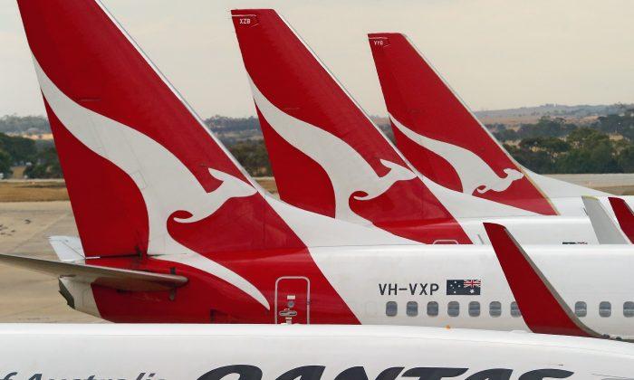 Qantas airplanes wait at Melbourne Tullamarine Airport in Melbourne, Australia, on Feb. 25, 2014. (Scott Barbour/Getty Images)