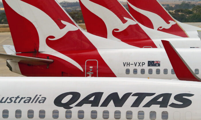 Qantas airplanes wait at Melbourne Tullamarine Airport in Melbourne, Australia on Feb. 25, 2014. (Scott Barbour/Getty Images)