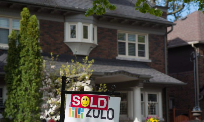 A sold sign is shown in front of a West End Toronto home in this file photo. Toronto has one of the lowest home ownership rates in Canada. (The Canadian Press/Graeme Roy)