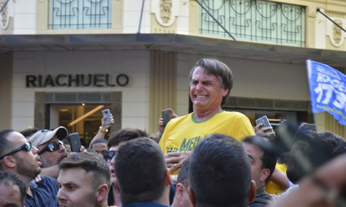Brazil Presidential candidate Jair Bolsonaro grimaces right after being stabbed in the stomach during a campaign rally in Juiz de Fora, Brazil, on Sept. 6, 2018. (AP/Raysa Leite)