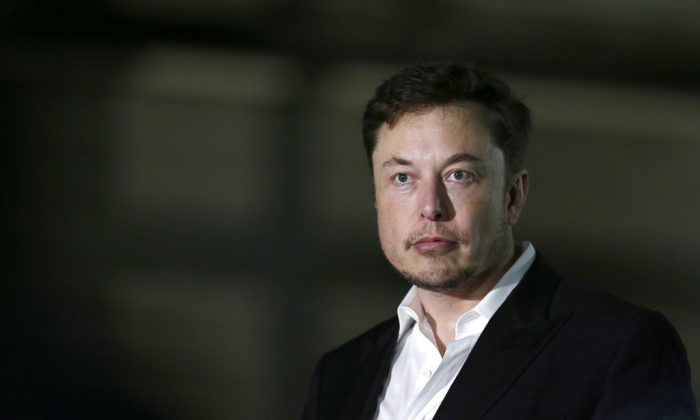 Tesla CEO and founder of the Boring Company Elon Musk speaks at a news conference in Chicago. Shares of electric car maker Tesla Inc. tumbled over 9 percent as the markets opened on Sept. 7, after the CEO smoked marijuana during a YouTube video podcast and the company's accounting chief left after a month on the job. (Kiichiro Sato/AP)