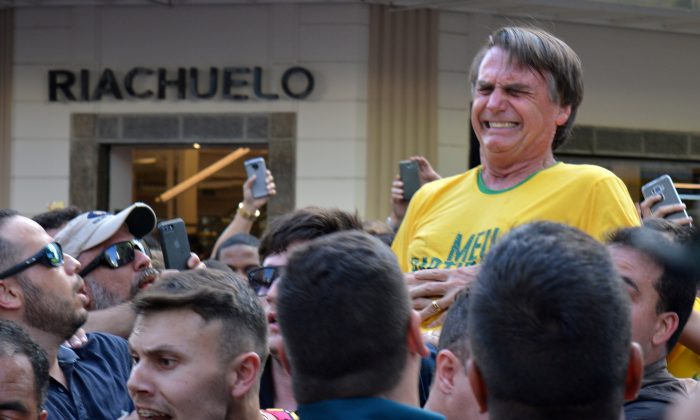 Brazilian presidential candidate Jair Bolsonaro reacts after being stabbed during a rally in Juiz de Fora, Brazil, on Sept. 6, 2018.  (Reuters/Raysa Campos Leite