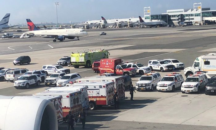 Emergency services are seen after passengers fell ill on a flight from New York to Dubai, on JFK Airport, New York on Sept. 05, 2018. (Larry Coben/via REUTERS)